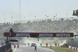 Fans throwing smoke flares on the track at the start of the race
