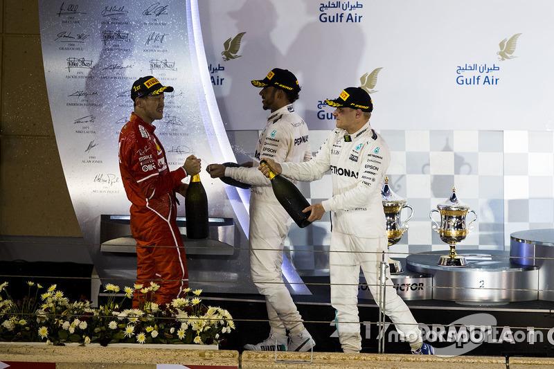 Podium: winner Sebastian Vettel, Ferrari, second place Lewis Hamilton, Mercedes AMG F1, third place