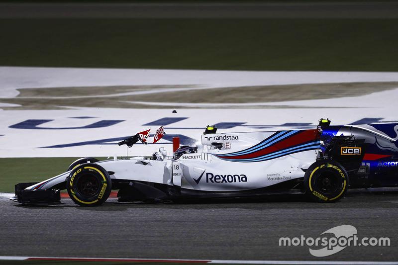Lance Stroll, Williams FW40, collides with Carlos Sainz Jr., Scuderia Toro Rosso STR12