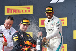 Max Verstappen, Red Bull Racing and Lewis Hamilton, Mercedes-AMG F1 celebrate on the podium with the champagne