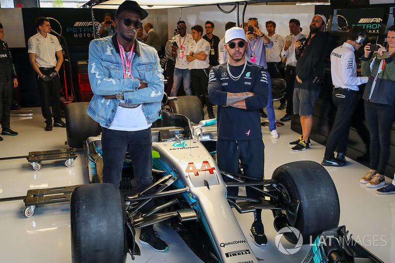 Usain Bolt, Lewis Hamilton, Mercedes AMG F1in the Mercedes AMG F1 garage