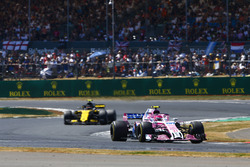 Esteban Ocon, Force India VJM11, leads Carlos Sainz Jr., Renault Sport F1 Team R.S. 18