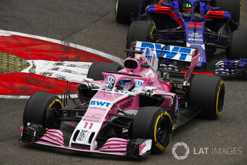 Sergio Perez, Force India VJM11, leads Brendon Hartley, Toro Rosso STR13 Honda
