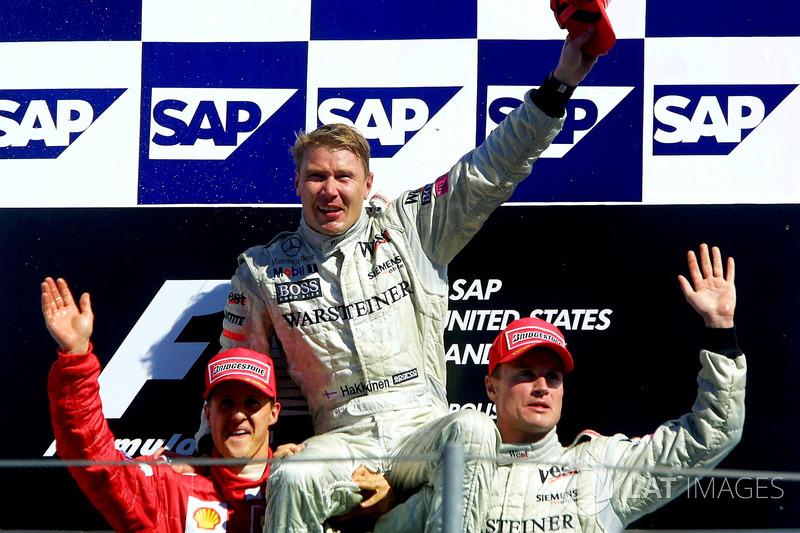 Podyum: 2. Michael Schumacher, Ferrari, yarış galibi Mika Hakkinen, McLaren, 3. David Coulthard, McLaren