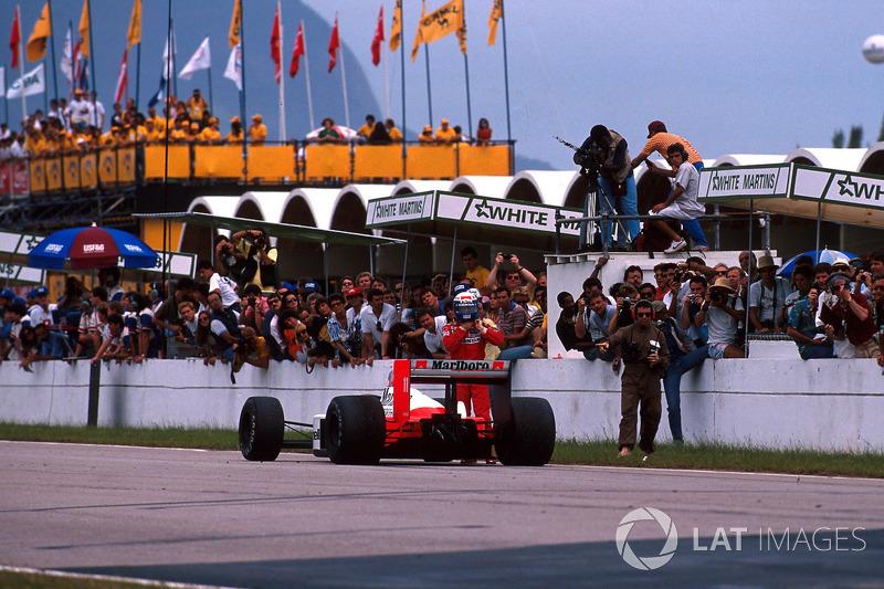 Race winner Alain Prost, McLaren MP4/4 parks his car on the start and finish straight
