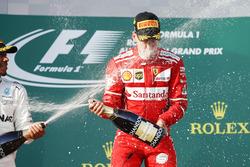 Lewis Hamilton, Mercedes AMG, 2nd Position, blasts Sebastian Vettel, Ferrari, 1st Position, with Champagne