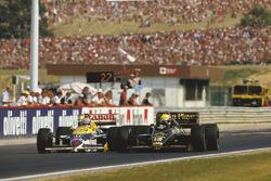 Ayrton Senna, Lotus 98T Renault overtakes Nigel Mansell, Williams FW11 Honda