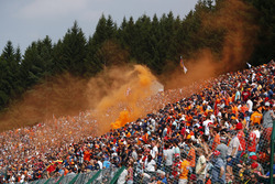 A large Dutch of fans contingent set off orange flares