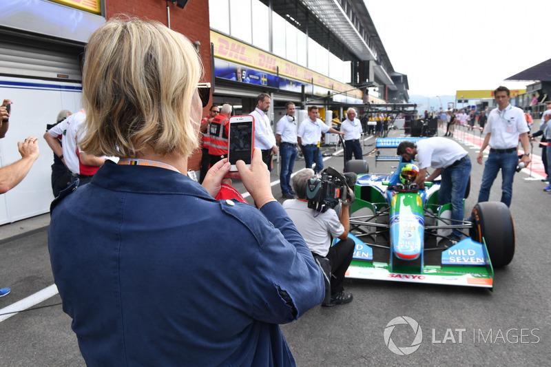 Sabine Kehm, takes a photo of Mick Schumacher, Benetton B194