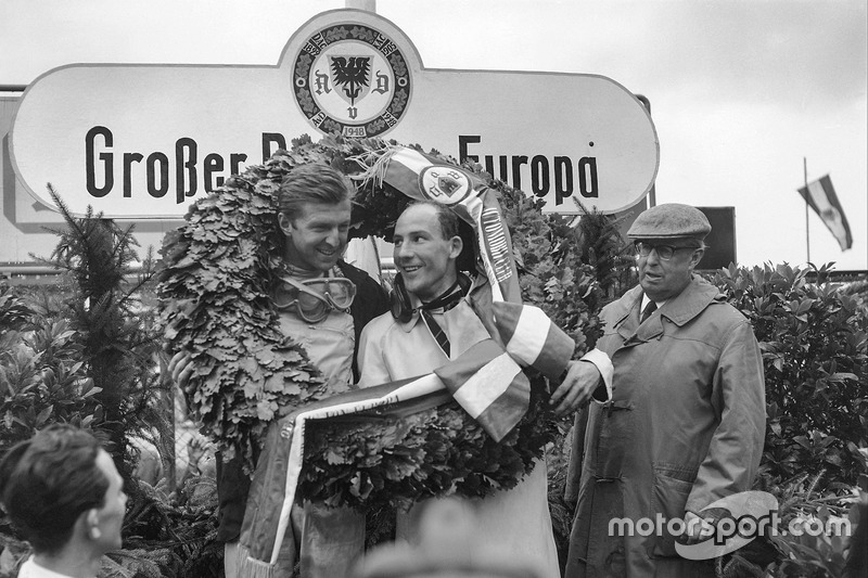 Wolfgang von Trips, and Stirling Moss, celebrate on the podium