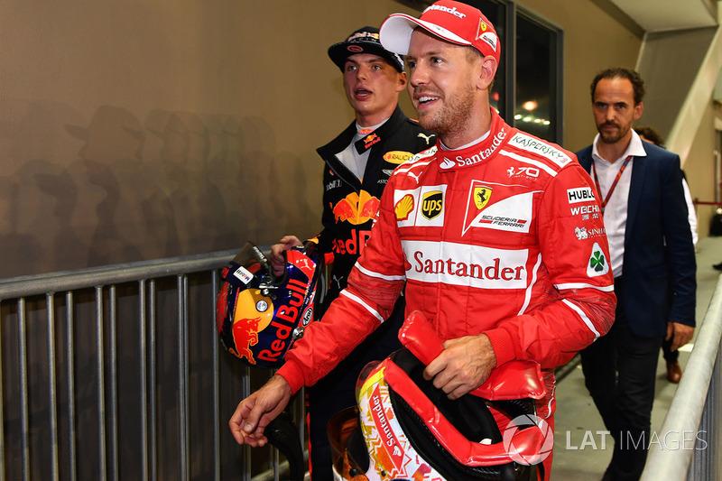 Sebastian Vettel, Ferrari and Max Verstappen, Red Bull Racing