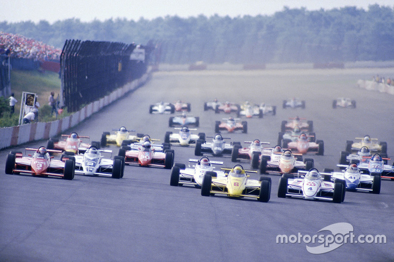 Pocono 1984, with Rick Mears' Penske-run March (6) leading Mario Andretti's Newman/Haas-run Lola (6) and Tom Sneva in the Mayer March. Howell misses the era of multiple chassis manufacturers and more engineering freedom for teams.