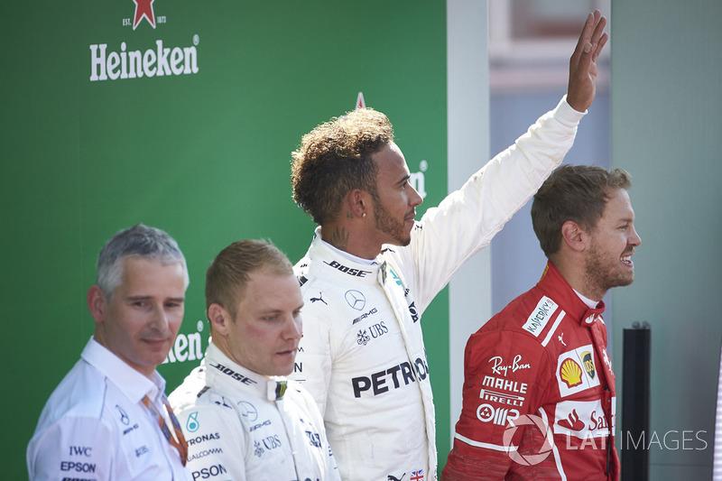 Second place Valtteri Bottas, Mercedes AMG F1, Race winner Third place Lewis Hamilton, Mercedes AMG F1 Sebastian Vettel, Ferrari, on the podium