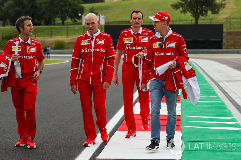 Sebastian Vettel, Ferrari walks the track with Jock Clear, Ferrari Chief Engineer, Riccardo Adami, Ferrari Race Engineer