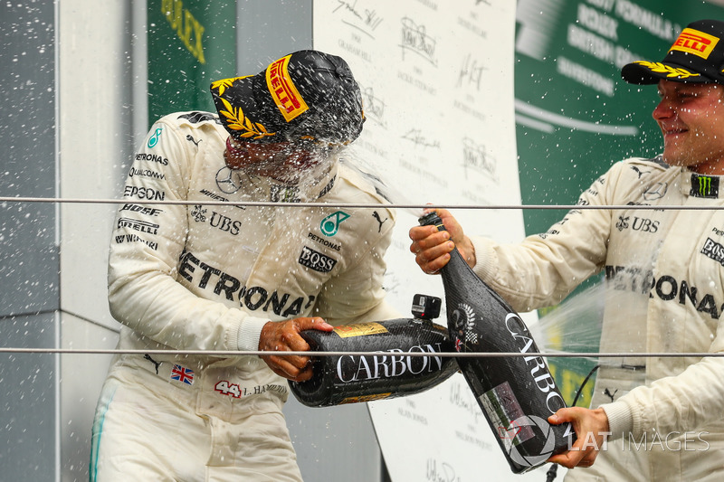Valtteri Bottas, Mercedes AMG F1 and Lewis Hamilton, Mercedes AMG F1 celebrate on the podium, the champagne
