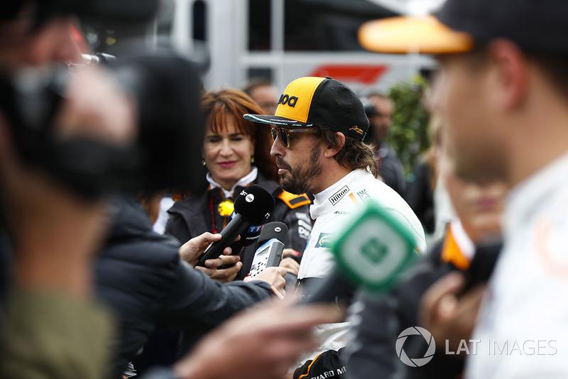Fernando Alonso, McLaren, and Stoffel Vandoorne, McLaren, talk to the media