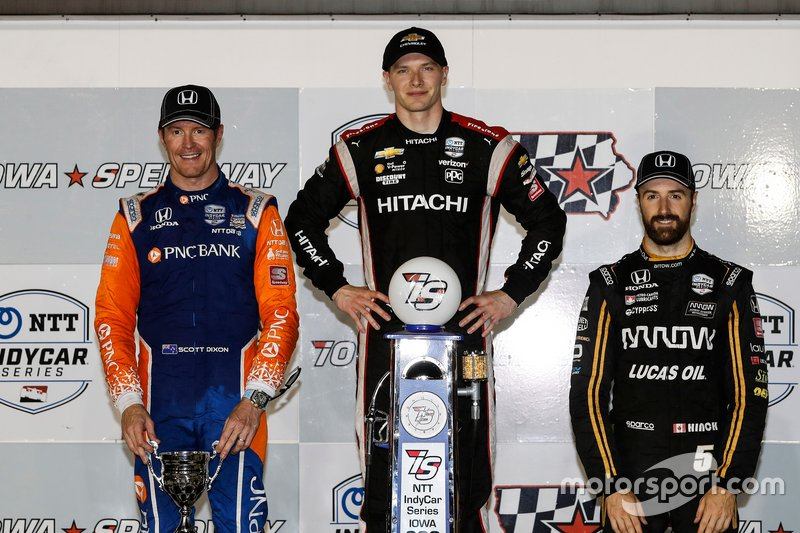 Scott Dixon, Josef Newgarden, and Arrow SPM's James Hinchcliffe pose on the podium after a long hard night of racing at Iowa Speedway.