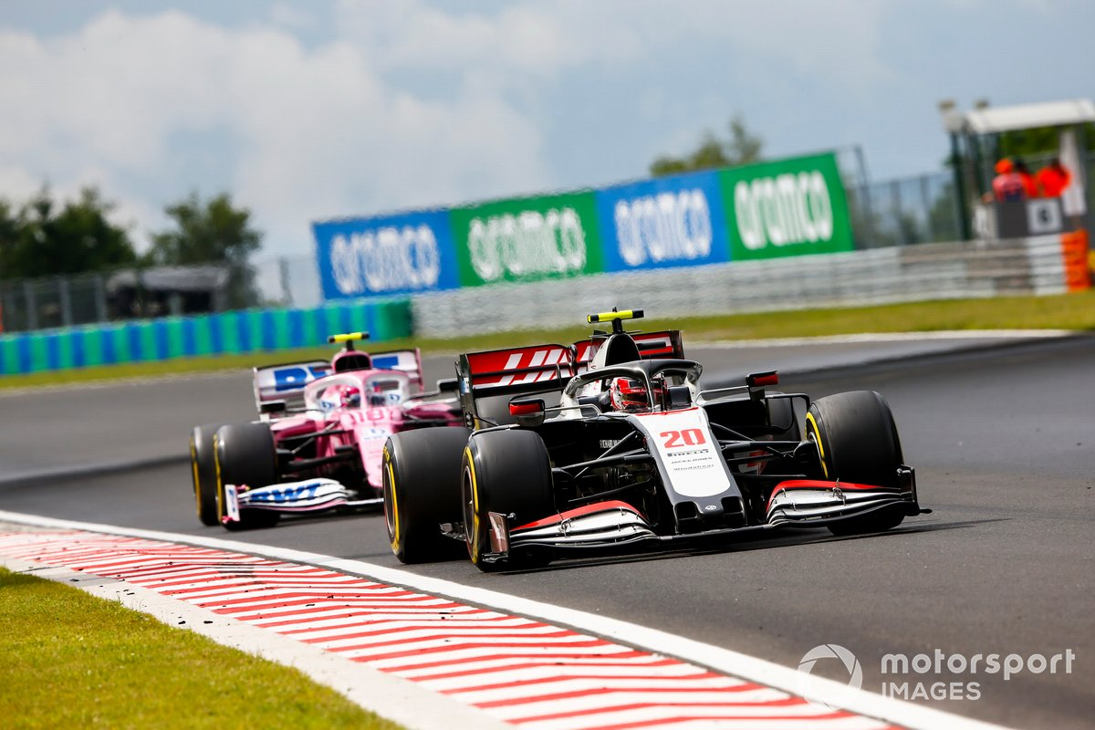 Kevin Magnussen, Haas VF-20, leads Lance Stroll, Racing Point RP20