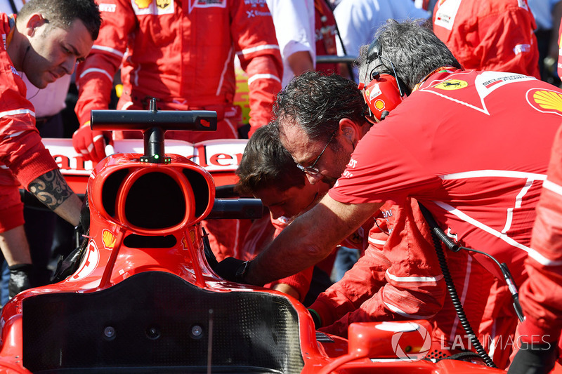 Ferrari mechanics work on the car of Sebastian Vettel, Ferrari SF70H
