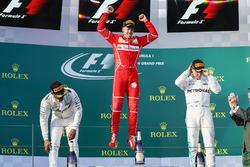Sebastian Vettel, Ferrari, 1st Position, Lewis Hamilton, Mercedes AMG, 2nd Position, and Valtteri Bottas, Mercedes AMG, 3rd Position, celebrate on the podium