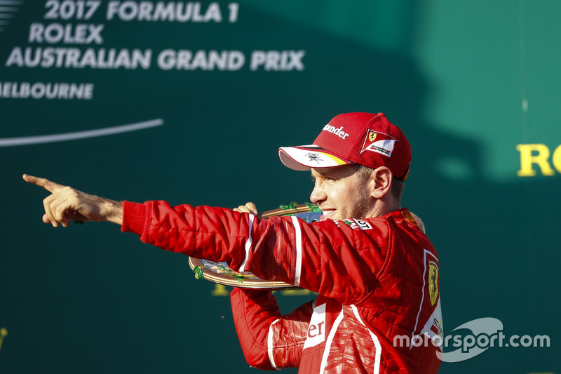 Sebastian Vettel, Ferrari, 1st Position, celebrates with his trophy