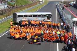 Group photo of marshals with Max Verstappen, Red Bull Racing