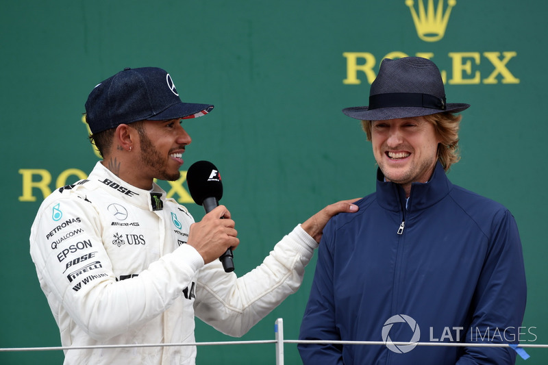Race winner Lewis Hamilton, Mercedes AMG F1 celebrates and Owen Wilson, Actor on the poidium