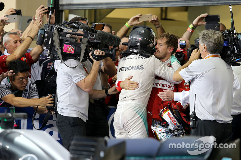 Second place and new world champion Nico Rosberg, Mercedes AMG F1 and Sebastian Vettel, Scuderia Ferrari