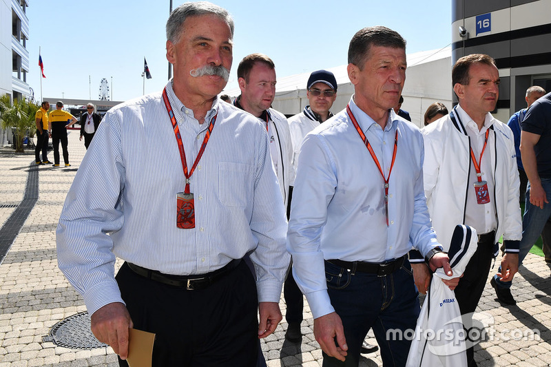 Chase Carey, Chief Executive Officer and Executive Chairman of the Formula One Group, Dmitry Kozak,