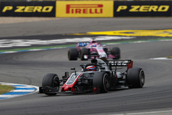 Romain Grosjean, Haas F1 Team VF-18, leads Sergio Perez, Force India VJM11
