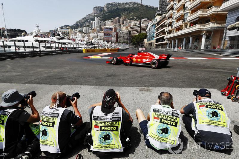 Photographers shoot Sebastian Vettel, Ferrari SF71H