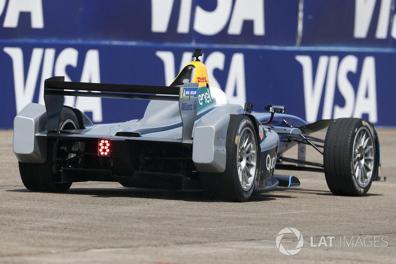 Model Emily Ratajkowski, drives the Formula E track car