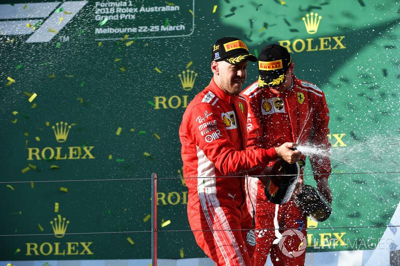 Race winner Sebastian Vettel, Ferrari and Kimi Raikkonen, Ferrari celebrate on the podium with the champagne