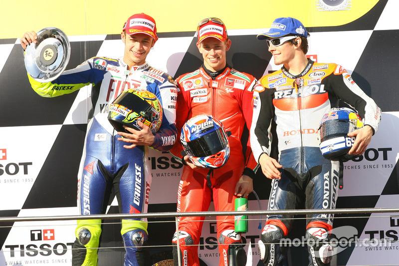 Podium: second place Valentino Rossi, Yamaha; Race winner Casey Stoner, Ducati; third place Nicky Ha