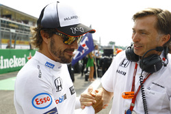 Fernando Alonso, McLaren on the grid with Jost Capito, McLaren Chief Executive Office