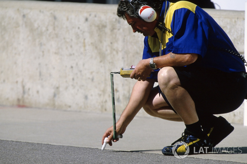 A Michelin tyre technician checks out the track temperatures