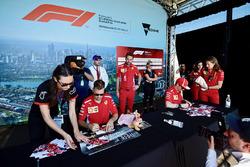 Sebastian Vettel, Ferrari and Kimi Raikkonen, Ferrari at the autograph session
