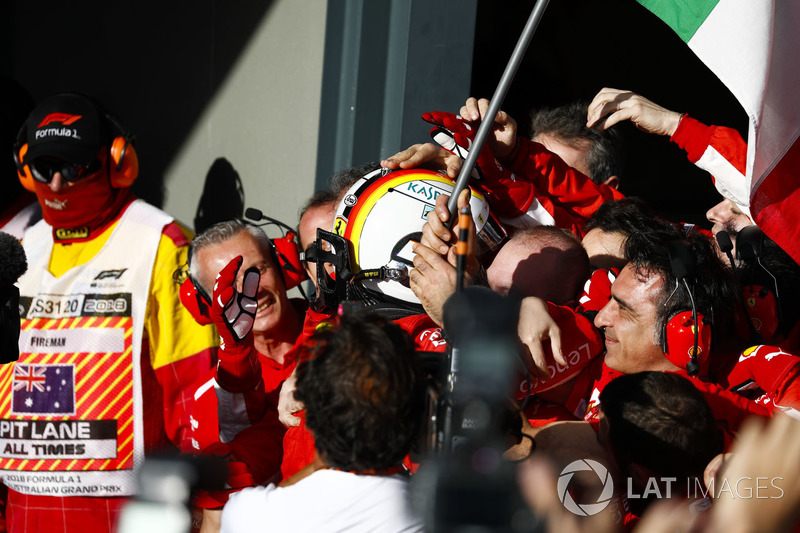 Race winner Sebastian Vettel, Ferrari, celebrates on arrival in Parc Ferme with his team