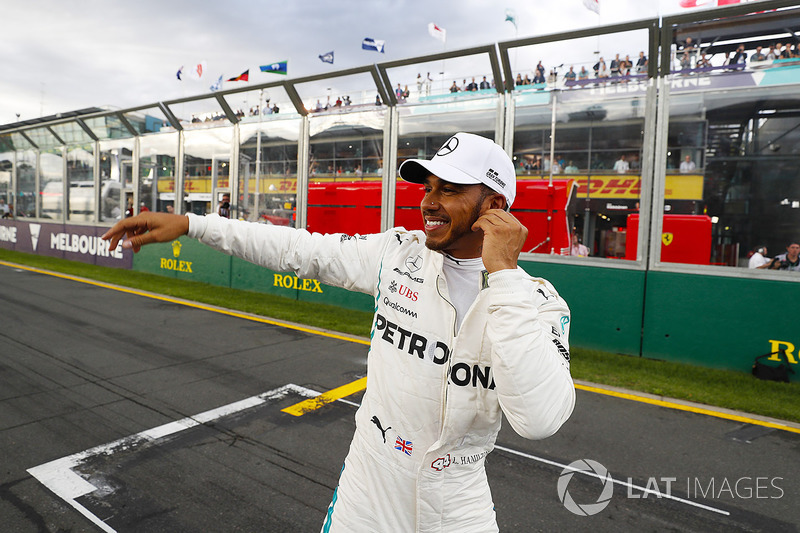 Lewis Hamilton, Mercedes AMG F1, celebrates taking pole position alongside on the pit straight