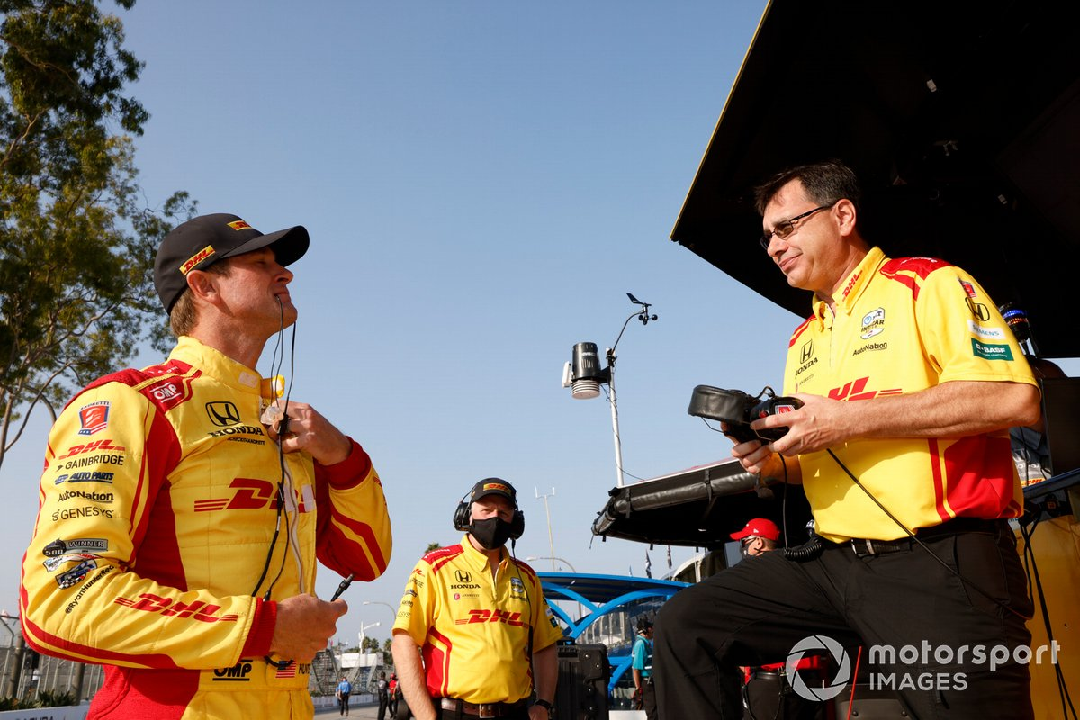 Ray Gosselin converses with Ryan Hunter-Reay before the veteran's last race with Andretti at Long Beach