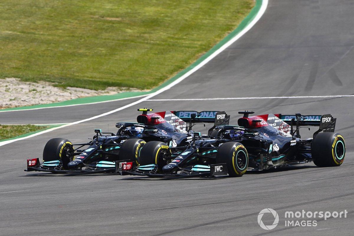 Lewis Hamilton, Mercedes W12, passes Valtteri Bottas, Mercedes W12
