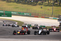 Max Verstappen, Red Bull Racing RB12 and Sergio Perez, Sahara Force India F1 VJM09 battle for positi