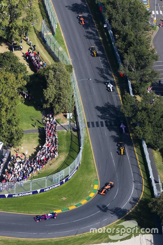 Daniil Kvyat, Scuderia Toro Rosso STR12, leads Fernando Alonso, McLaren MCL32, and Nico Hulkenberg,