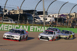 Sam Hornish Jr, Discount Tire Ford Mustang and Kyle Benjamin, Joe Gibbs Racing Toyota