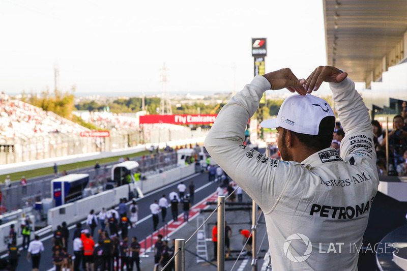 Race winner Lewis Hamilton, Mercedes AMG F1, does the Mobot on the podium