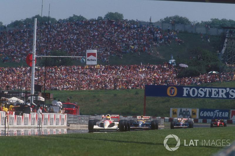 Ayrton Senna, McLaren MP4/6 Honda lidera a Nigel Mansell, Williams FW14 Renault, Riccardo Patrese, Williams FW14 Renault y Alain Prost, Ferrari 643