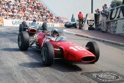 Lorenzo Bandini, Ferrari 158/246 leads Graham Hill, BRM P261