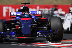 Daniil Kvyat, Scuderia Toro Rosso STR12, lifts a wheel over a kerb