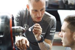 Engineers discuss the car in the McLaren garage