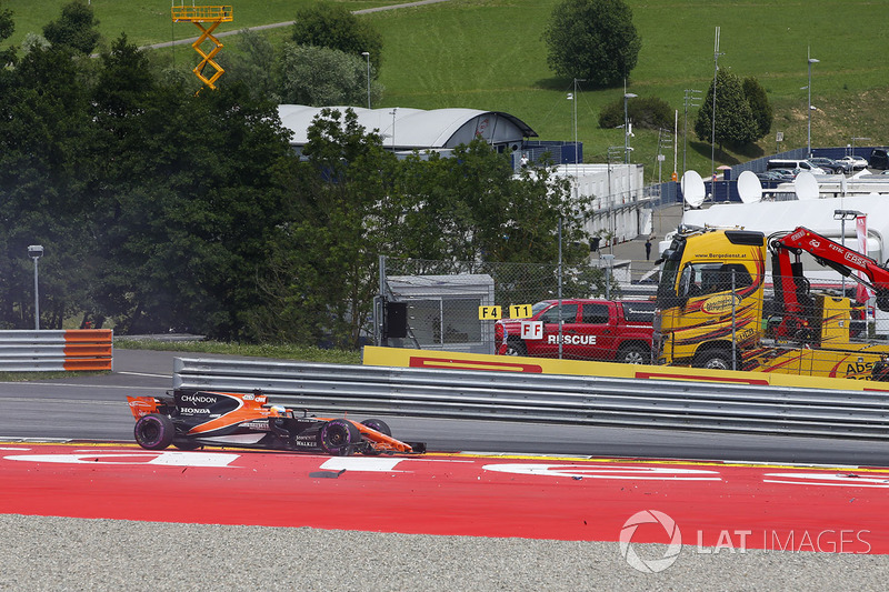 Fernando Alonso, McLaren MCL32, recovers after a hit causes race ending damage to his car